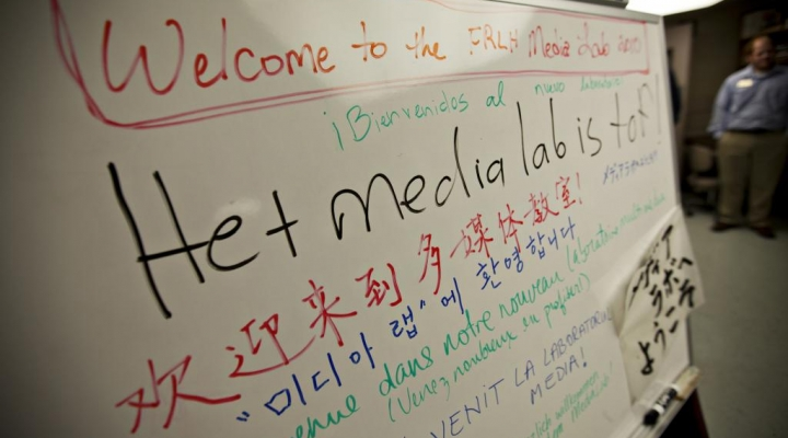 White board displays welcoming messages in multiple languages